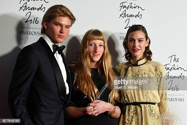 Designer Molly Goddard poses in the winners room with presenters Jordan Kale Barrett and Alexa Chung after winning the award for British Emerging...