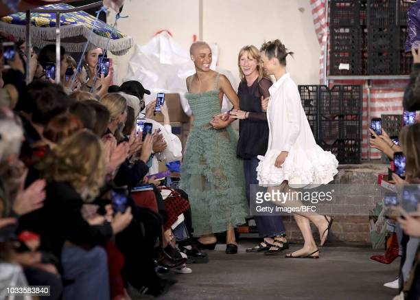 Designer Molly Goddard walks the runway with Adwoa Aboah and Edie Campbell at the Molly Goddard show during London Fashion Week September 2018 at 26...