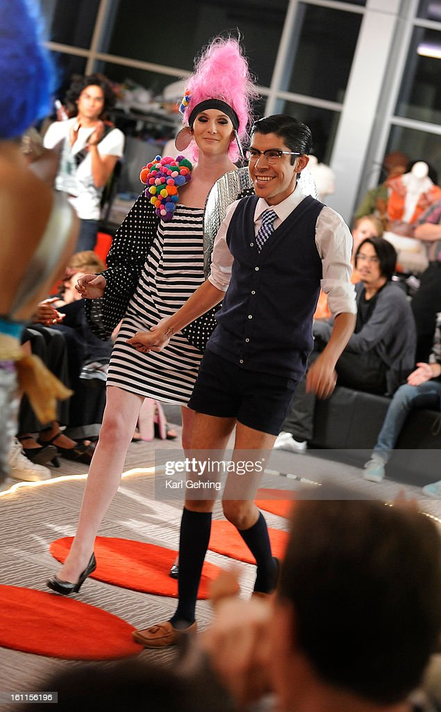 "Designer Mondo celebrated his win in an offbeat style competition at the Denver Art Museum Friday night. With the help of assistant Meredith Murphy clothing designer Armando Guerra (""Mondo"") put together a new outfit out of recycled cloth, raw materials a : News Photo"