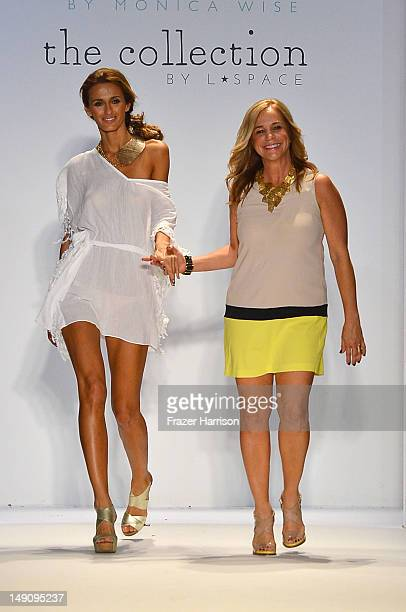 Designer Monica Wise walks the runway with a model at the L Space By Monica Wise show during Mercedes-Benz Fashion Week Swim 2013 at The Raleigh on...