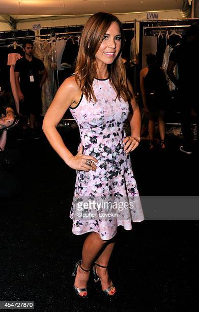 Designer Monique Lhuillier poses backstage at the Monique Lhuillier fashion show during MercedesBenz Fashion Week Spring 2015 at The Theatre at...