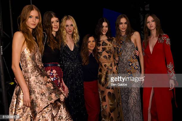 Designer Monique Lhuillier poses backstage with models at the Monique Lhuillier Fall 2016 fashion show during New York Fashion Week The Shows at The...