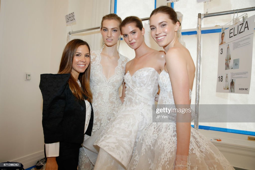 Designer Monique Lhuillier poses with models backstage at the Monique Lhuillier Spring 2018 Bridal show at Carnegie Hall on April 21, 2017 in New York City.