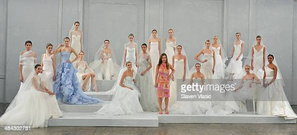 Designer Monique L'huillier poses with models during the Monique Lhuillier Spring 2015 Bridal collection show on April 11 2014 in New York City