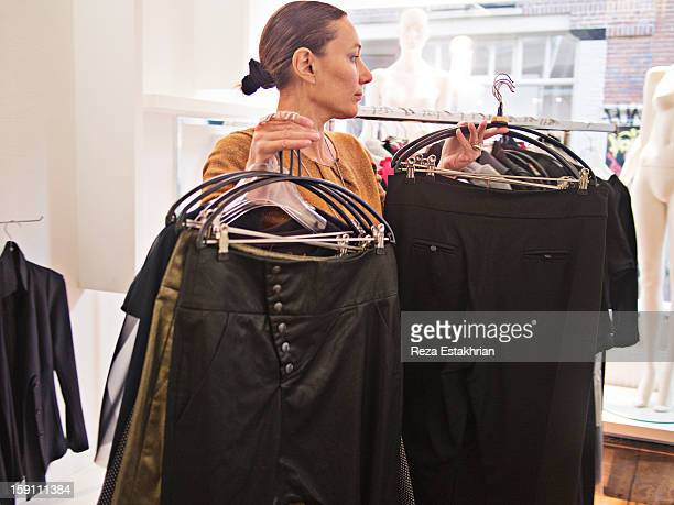 Designer moves garments to new positions