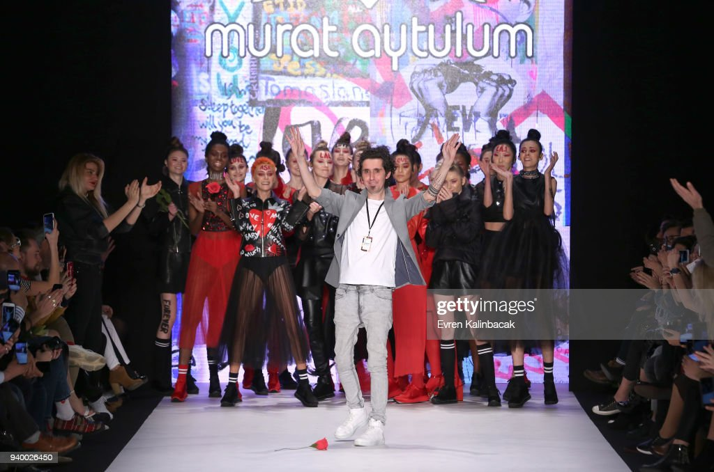 Designer Murat Aytulum and models acknowledge the applause of the audience after the Murat Aytulum show during Mercedes Benz Fashion Week Istanbul at Zorlu Performance Hall on March 30, 2018 in Istanbul, Turkey.