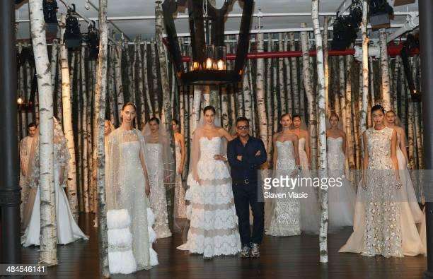 Designer Naeem Kahn poses at the Naeem Kahn Spring 2015 Bridal collection presentation on April 12 2014 in New York City