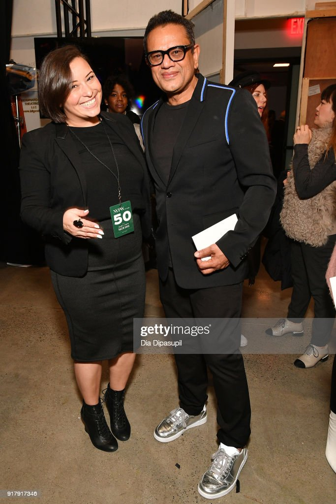 Designer Naeem Khan (R) and a guest pose backstage for Naeem Khan during New York Fashion Week: The Shows at Gallery I at Spring Studios on February 13, 2018 in New York City.