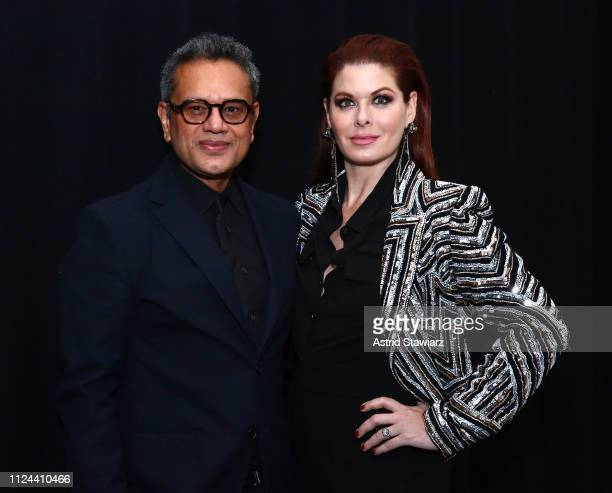 Designer Naeem Khan and Debra Messing pose backstage for TRESemme at the Naeem Khan show during NYFW on February 12 2019 in New York City