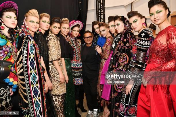 Designer Naeem Khan and models pose backstage for Naeem Khan during New York Fashion Week The Shows at Gallery I at Spring Studios on February 13...