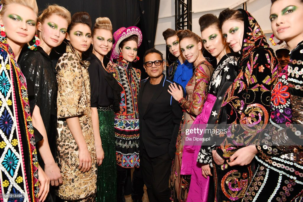 Designer Naeem Khan and models pose backstage for Naeem Khan during New York Fashion Week: The Shows at Gallery I at Spring Studios on February 13, 2018 in New York City.