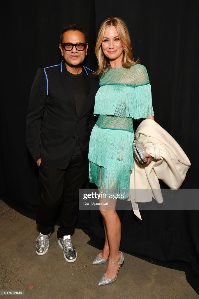 Designer Naeem Khan and recording artist Jennifer Nettles backstage for Naeem Khan during New York Fashion Week: The Shows at Gallery I at Spring Studios on February 13, 2018 in New York City.