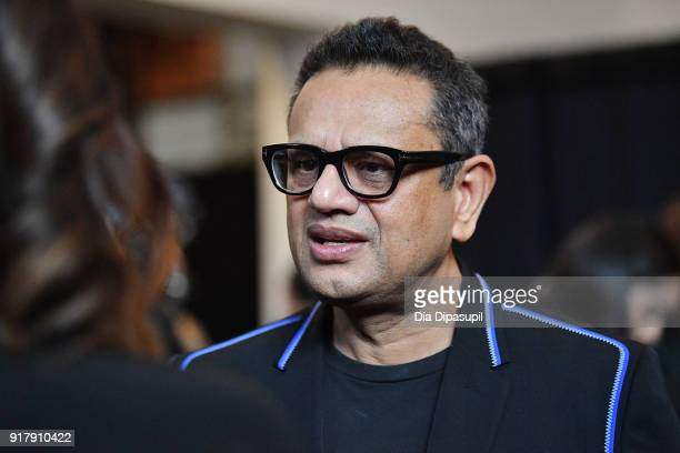Designer Naeem Khan gives an interview backstage for Naeem Khan during New York Fashion Week The Shows at Gallery I at Spring Studios on February 13...