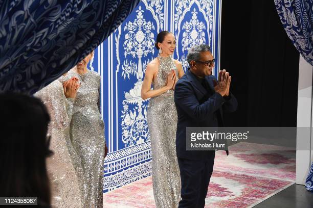 Designer Naeem Khan greets the audience with model Pat Cleveland at the Naeem Khan show during New York Fashion Week The Shows at Gallery I at Spring...
