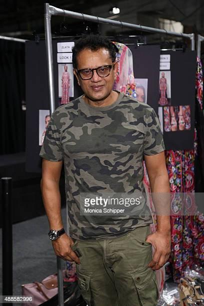 Designer Naeem Khan poses backstage at Naeem Khan Spring 2016 during New York Fashion Week The Shows at The Arc Skylight at Moynihan Station on...