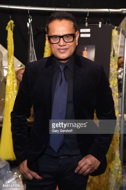 Designer Naeem Khan poses backstageprior to the Naeem Khan fashion show during New York Fashion Week at Gallery 1 Skylight Clarkson Sq on September...