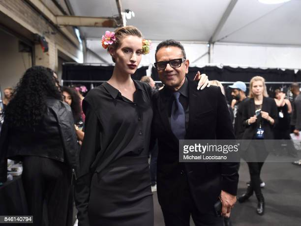 Designer Naeem Khan poses with a model backstage for TRESemme at Naeem Khan NYFW SS18 on September 12 2017 in New York City