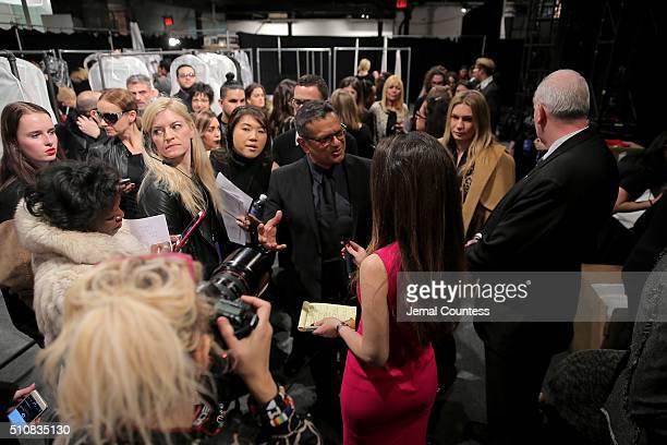 Designer Naeem Khan prepares backstage at the Naeem Khan Fall 2016 fashion show during New York Fashion Week The Shows at The Arc Skylight at...