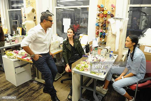 Designer Naeem Khan prepares backstage with Mary Kay at the Naeem Khan Bridal Fall/Winter 2016 Runway Show on October 9 2015 in New York City