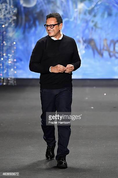 Designer Naeem Khan walks the runway at the Naeem Khan fashion show during MercedesBenz Fashion Week Fall 2015 at The Theatre at Lincoln Center on...