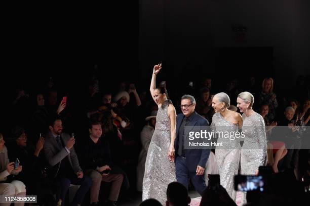 Designer Naeem Khan walks the runway with models Pat Cleveland Alva Chinn and Karen Bjornson at the Naeem Khan show during New York Fashion Week The...
