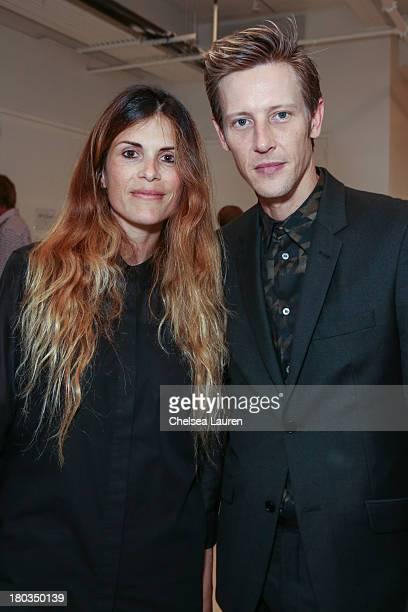 Designer Natalie Ratabesi and actor Gabriel Mann pose backstage at the Philosophy by Natalie Ratabesi fashion show during MercedesBenz Fashion Week...