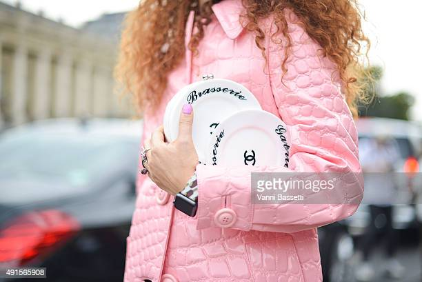 Designer Natasha Zinko poses wearing a Miu miu coat and Chanel clutch after the Chanel show at the Grand Palais during Paris Fashion Week SS16 on...