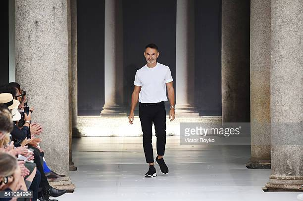Designer Neil Barrett acknowledges the applause of the audience at the runway at the Neil Barrett show during Milan Men's Fashion Week Spring/Summer...