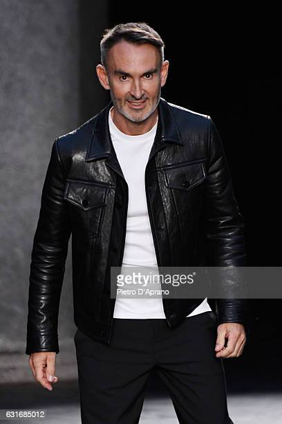 Designer Neil Barrett acknowledges the applause of the audience at the Neil Barrett show during Milan Men's Fashion Week Fall/Winter 2017/18 on...