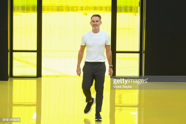 Designer Neil Barrett acknowledges the applause of the audience at the Neil Barrett show during Milan Men's Fashion Week Spring/Summer 2019 on June...