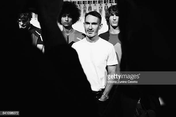 Designer Neil Barrett poses backstage with models ahead of the Neil Barrett show during Milan Men's Fashion Week Spring/Summer 2017 on June 18 2016...