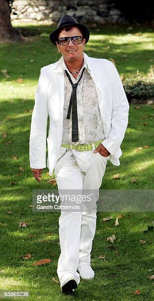 Designer Nicky Haslam attends the wedding of musician Jools Holland and Christabel McEwen at St James's Church Cooling on August 30 2005 in Cooling...