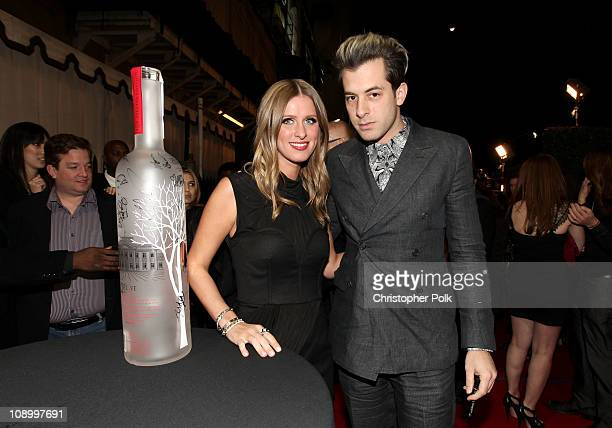 Designer Nicky Hilton and DJ Mark Ronson sign the RED bottle at the RED launches with Usher on February 10 2011 in Hollywood California