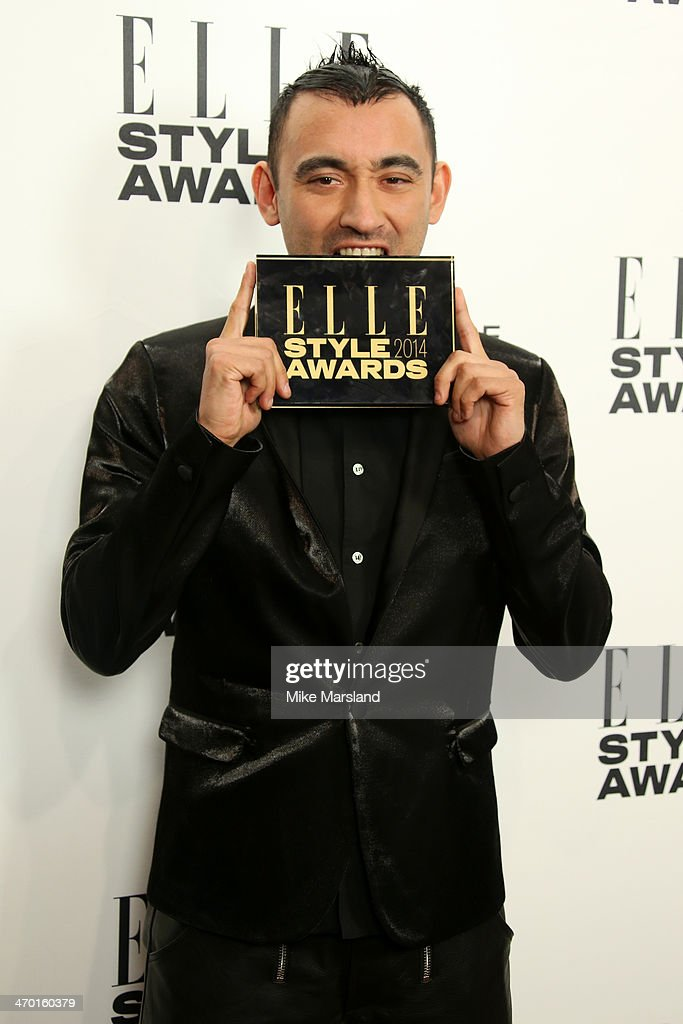 Designer Nicola Formichetti, winner of the Fashion Innovator Award, poses in the winners room at the Elle Style Awards 2014 at one Embankment on February 18, 2014 in London, England.