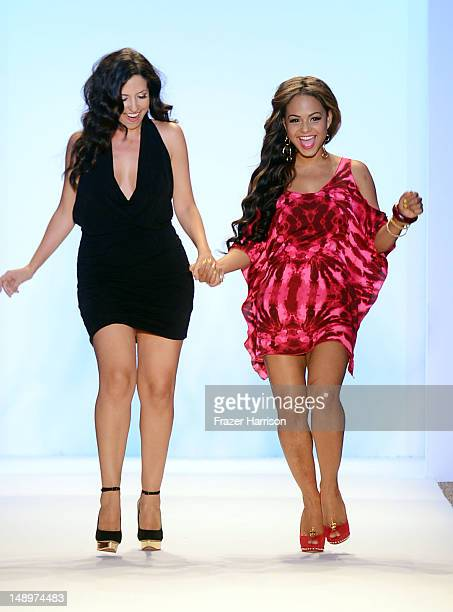 Designer Nicole Di Rocco and Christina Milian walk the runway at the Nicolita show during MercedesBenz Fashion Week Swim 2013 at The Raleigh on July...