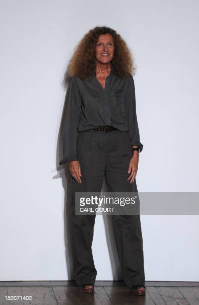 Designer Nicole Farhi acknowledges the audience after showing her 2013 spring/summer collection at London Fashion Week in London on September 16 2012...