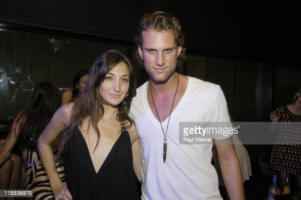 Designer Nicole Romano left poses with promoter Ariel Stein at the after show party for Designer Nicole Romano at Marquee during New York Fashion...