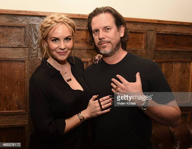 Designer Nikki Erwin and producer Chuck Pacheco attend the Established Jewelry By Nikki Erwin Launch Party Hosted By Erin Sara Foster on March 5 2015...