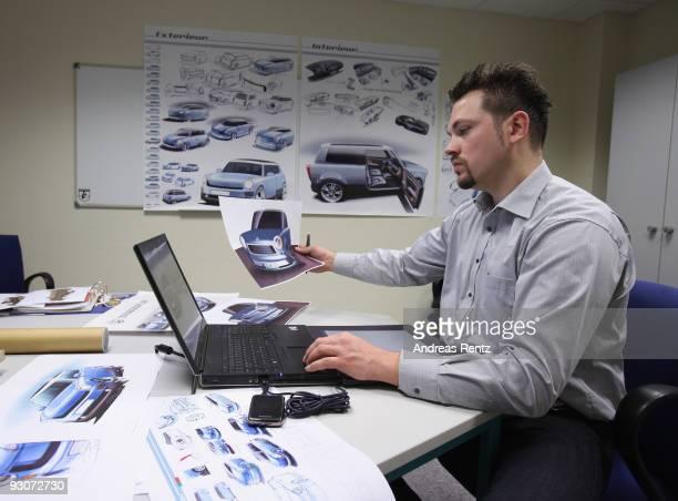 Designer Nils Poschwatta works on designs for the new Trabant nT on November 12 2009 in WilkauHasslau near Zwickau Germany Auto body manufacturer...
