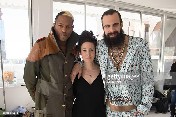 Designer Nina Athanasiou poses with models backstage at the Nina Athanasiou fashion show during Mercedes Benz Fashion Week Fall 2015 at The...