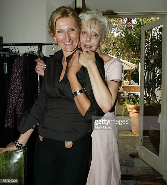 Designer Nina Morris and Patric Reeves attend the Nina Morris Trunk Show at Patric Reeves' home August 21 2004 in Los Feliz California
