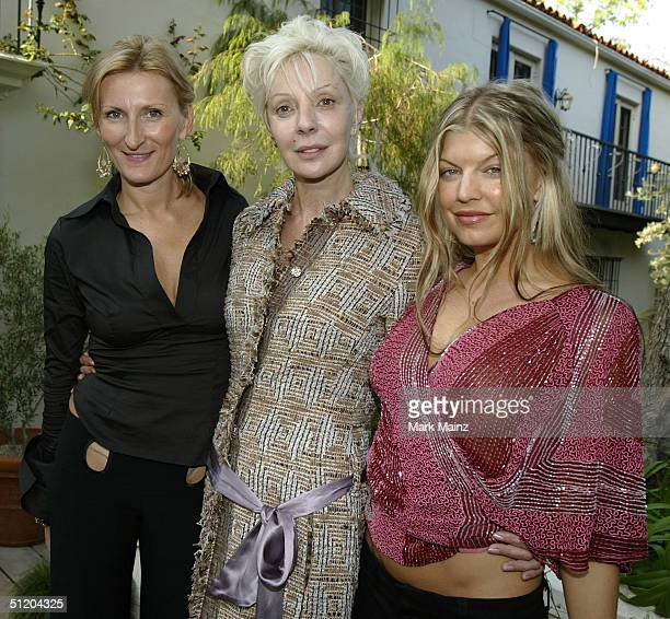 Designer Nina Morris Patric Reeves and Black Eyed Peas singer Fergie attend the Nina Morris Trunk Show at Patric Reeves' home August 21 2004 in Los...
