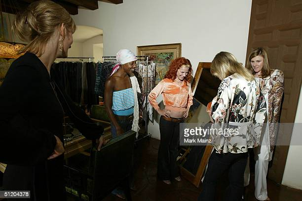 Designer Nina Morris stylist Nonja McKenzie and musician Nikka Costa attend the Nina Morris Trunk Show at Patric Reeves' home August 21 2004 in Los...