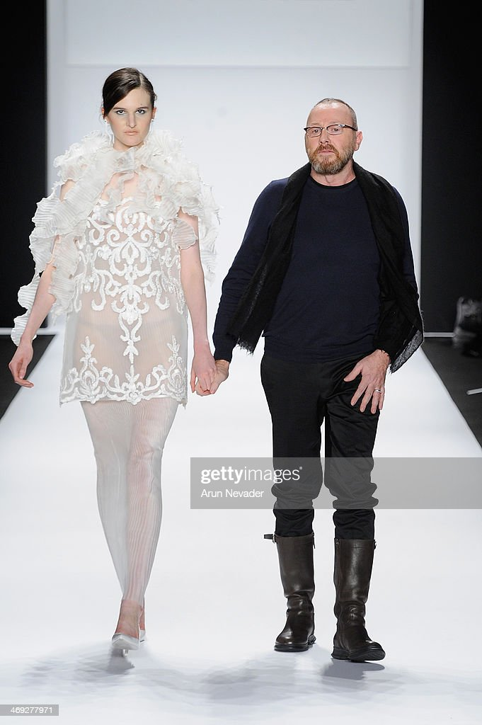 Designer Nino Lettieri and a model walk the runway at the FLT Moda + Art Hearts Fashion show presented by AIDS Healthcare Foundation during Mercedes-Benz Fashion Week Fall 2014 at The Theatre at Lincoln Center on February 13, 2014 in New York City.