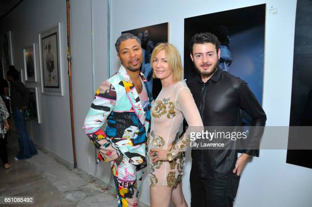 Designer Octavius Terry artist Karen Bystedt and Max Sharp attend Karen Bystedt's 'Kings And Queens' exhibition on March 9 2017 in Los Angeles...