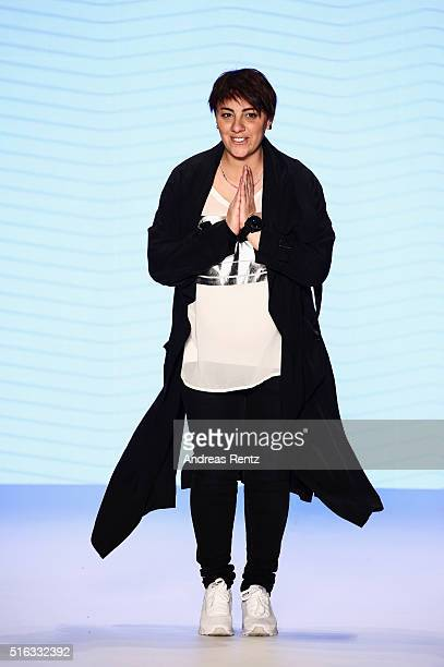 Designer Oezlem Erkan acknolwdges the applause of the audience at the Oezlem Erkan show during the MercedesBenz Fashion Week Istanbul Autumn/Winter...