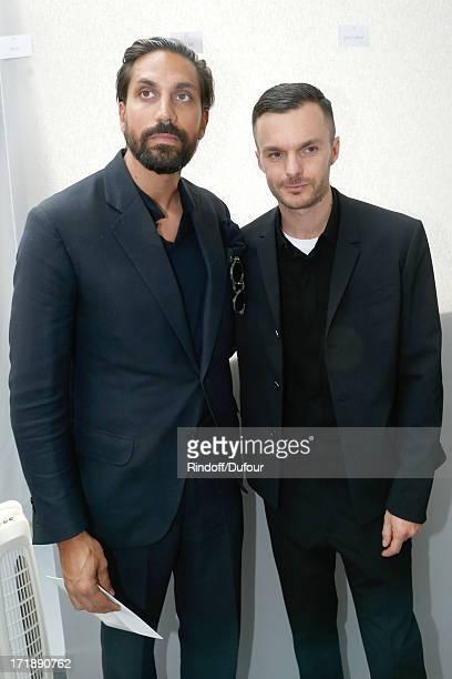 Designer of perfumes Byredo Ben Gorham and Fashion designer Kris Van Assche backstage after Dior Homme Menswear Spring/Summer 2014 Show as part of...