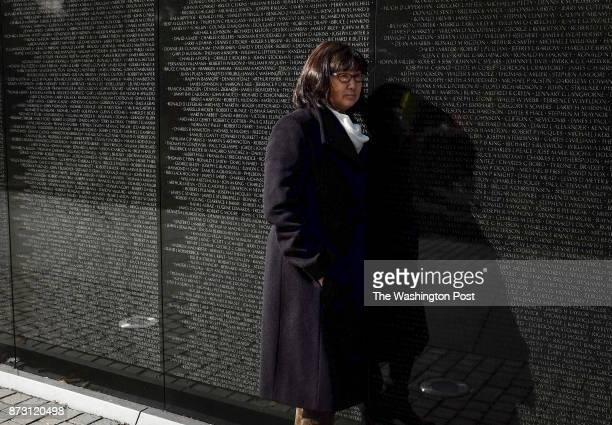 Designer of the wall Maya Lin revisits her creation before ceremonies to commemorate the 35th anniversary of the Vietnam Memorial on Veterans day on...