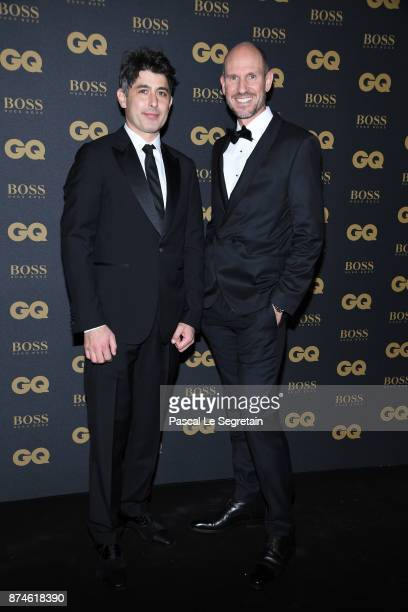 Designer of the year Tristan Auer and a guest attend GQ Men Of The Year Awards 2017 at Le Trianon on November 15 2017 in Paris France