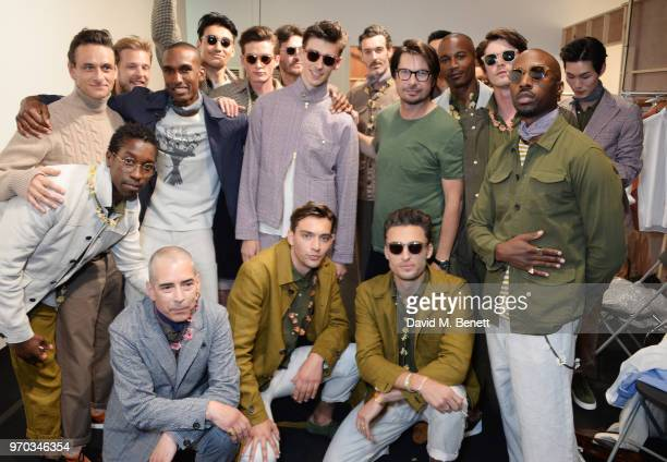 Designer Oliver Spencer poses with models backstage at the Oliver Spencer Catwalk Show SS 2019 during London Fashion Week Men's June 2018 at 180 The...